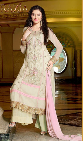 Beige embroidered designer knee length salwar suits with pink dupatta