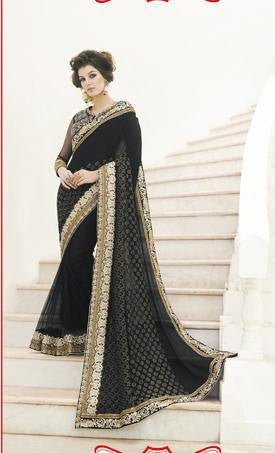 Dazzling black with heavy zaree work and silk blouse