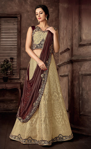 Cream Jacquard Silk Party Wear Lehenga With Maroon Dupatta