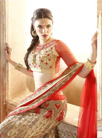 Beige and red bridal heavy embroidered lehenga with heavy border