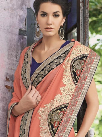 Orange Saree with heavy lace border and stone work
