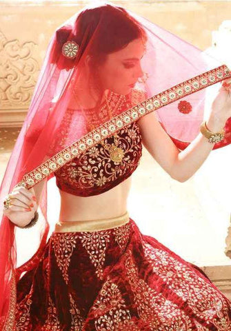 Maroon bridal heavy designer lehenga with velvet fabric and heavy embroidered work