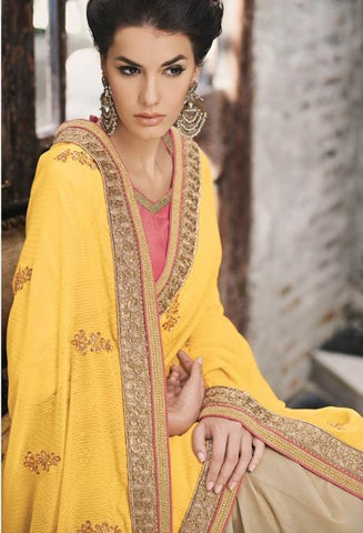 Yellow, golden saree with zari lace and contrasting pink blouse