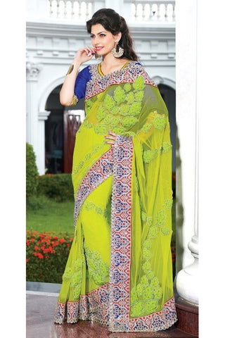 Women In green saree and blue blouse with net pallu , inner shantung, and blouse is of dhupian