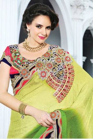 Green color heavy embroidered sarees , fabric is of jacquard, sarees is below Rs  10000