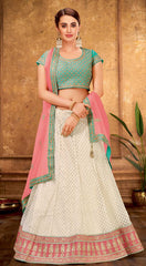Cream Net Party Wear Lehenga With Light Blue Choli And Peach Dupatta