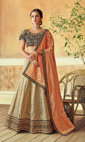 Cream Jacquard Silk Party Wear Lehenga With Peach Dupatta