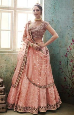 Peach Net Party Wear Lehenga With Purple Dupatta