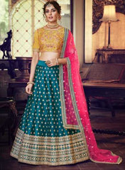 Peacock Blue Silk Party Wear Lehenga With Mustard Yellow Choli And Pink Dupatta