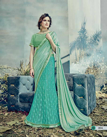 Aqua Green Net Saree With Green Blouse