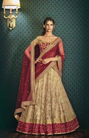 Beige Net Leaf Motif Skirt With Maroon Blouse With Net Maroon Zari Embroidered Pallu