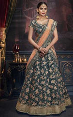 Blue Handloom Silk Party Wear Lehenga With Blue Choli And Peach Dupatta