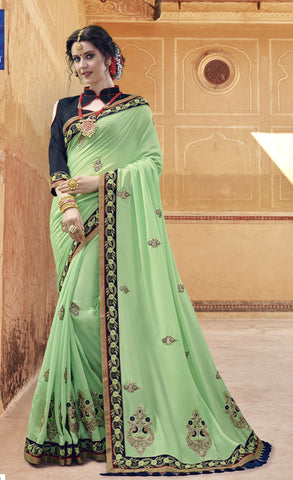 Green Georgette Party Wear Saree With Dark Blue Blouse