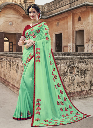 Green Georgette Party Wear Saree With Maroon Blouse