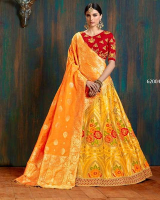 Yellow Silk Wedding Wear Lehenga With Orange Dupatta