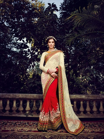 Its a sheer beauty of heaven, work are simply heavenly   White pallu with contrasting shade of red such a heavy border make this sari a true bridal saree as fabric is concern net pallu Georgette saree with art silk blouse