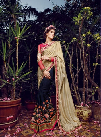 Stunner saree, with beige and red blouse and black base with such a big ghera  Pallu of crape pattern, base of bembreng georgette , blouse is of art silk cloth