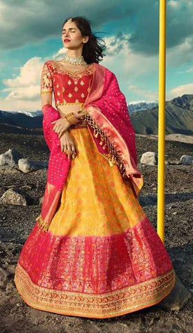 Yellow Silk Party Wear Lehenga With Red Choli And Pink Dupatta