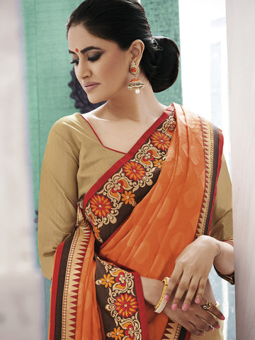 Beige saree with orange pallu