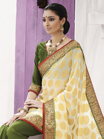 Green saree with heavy border and beige color pallu