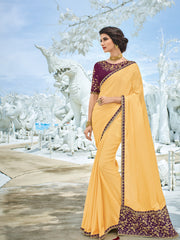 Yellow Silk Party Wear Saree With Purple Blouse