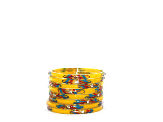 Yellow designer glass bangles with bead and gem work