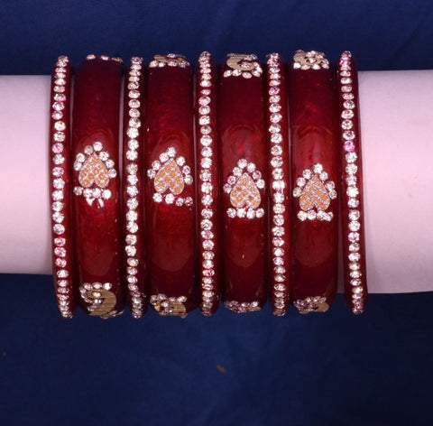 Red Nakshtra Luv glass bangles with golden sparkling design