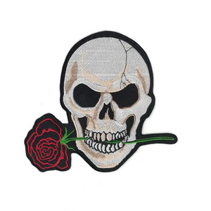 skeleton skull biting down on a rose
