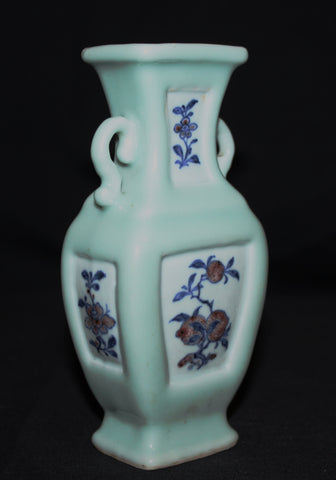 A celadon ground small baluster vase.
