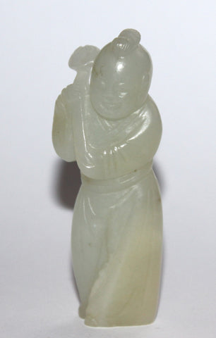 A Chinese jade figure of a boy. 18th Century.
