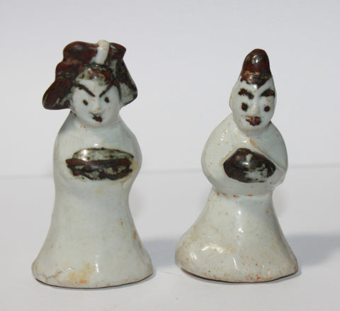 A pair of Korean porcelain miniature figures.