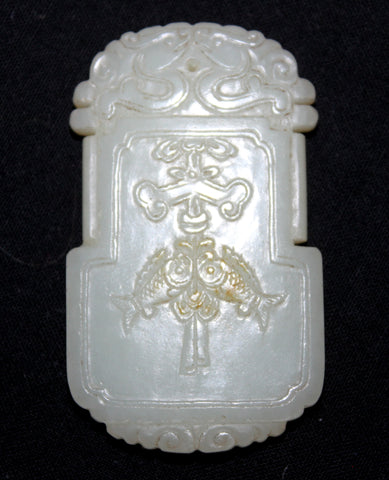 A Chinese 18th Century white jade pendant.
