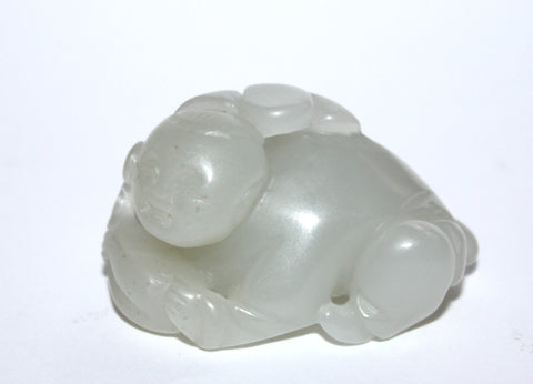 A Chinese jade figure of a boy. 19th Century.