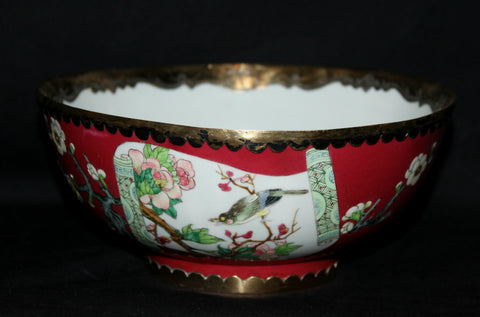 A Chinese famille rose bowl with gilt mounts.