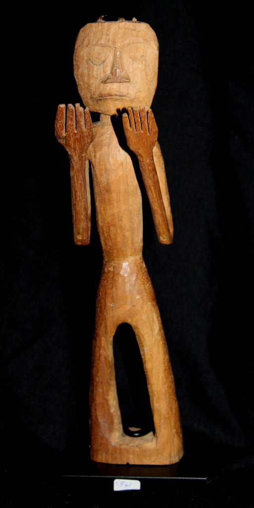 A North West Coast puppet figure.