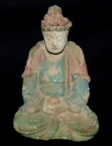 A Ming Dynasty painted wooden carving of Guanyin.