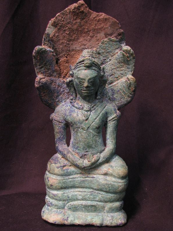 A Javanese bronze figure of buddha with makalinda. - asianartlondon