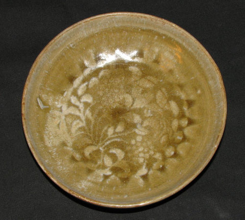 A celadon floral decorated molded dish.