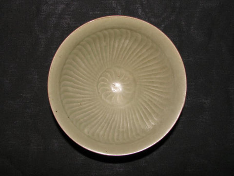 A Chinese Northern celadon bowl with fluted decoration to the interior.