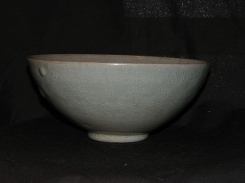 A Korean celadon moulded bowl.