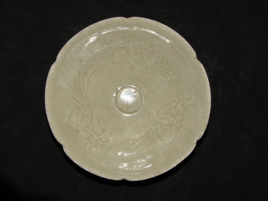 A Qingbai fluted shallow bowl with floral decoration. - asianartlondon