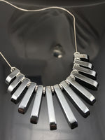 Hematite Graduated Fan Necklace - Giulian Lyn