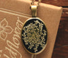 Queen Anne's Lace Black Oval Resin Pendant