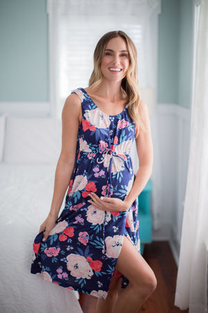 Annabelle labor gown with navy background and a flowered print. Labor gowns are an excellent option for delivery with an elastic waist, snap shoulders, and a wrap waist for coverage.