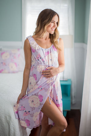 Pink delivery gown for labor and delivery. Perfect gown for birth with newborn. Easy access dress for pregnancy and childbirth. Match with mommy outfit. Matching style for family. Maternity photoshoot, matching family for baby girl. Pastel purple and pink floral pattern. Get your hospital bag ready for the big day.