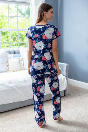 Maternity pajamas for hospital wear and beyond! Annabelle print with navy background, large cream flowers, blue petals, and smaller pink flowers. Feminine and stylish print to outfit the whole family.