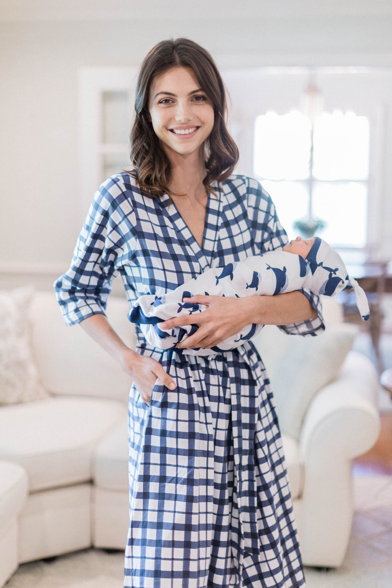 Blue gingham printed robe with 3/4 sleeves and belt tie. Buy the set and save with Whale baby swaddle and robe set. Blue whales against white background with navy colored trim.