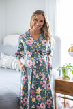 Maternity robe for mom-to-be with pink and yellow flowers against a deep green background. The Charlotte print is perfect for bold, feminine moms.