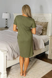 Olive green house dress, knee length, gold snaps, and short sleeves.