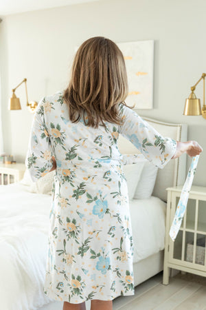 Hadley printed maternity robe with cream and blue flowers against a white background. An excellent neutral option for mom and baby.